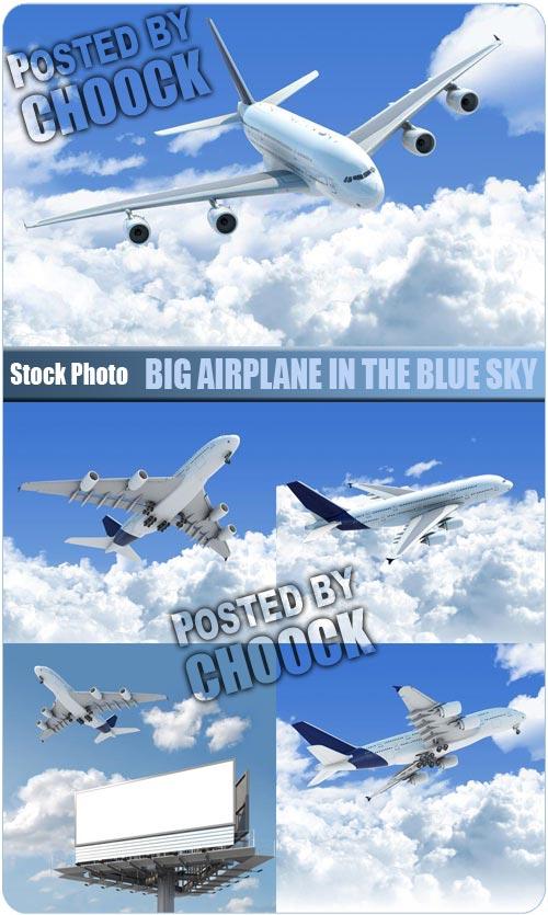 دانلود تصاویر استوک هواپیما Big airplane in the blue sky - Stock Photo
