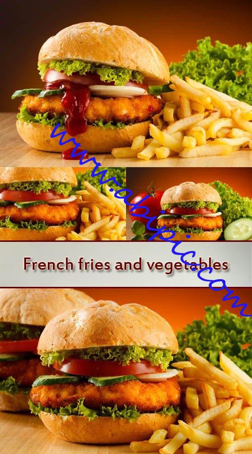 دانلود تصاویر استوک همبرگر به همراه سیب زمینی سرخ کرده و سبزیجات
