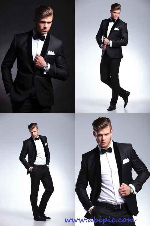 عکس استوک مرد در لباس رسمی میهمانی Business man poses in tuxedo stock photo
